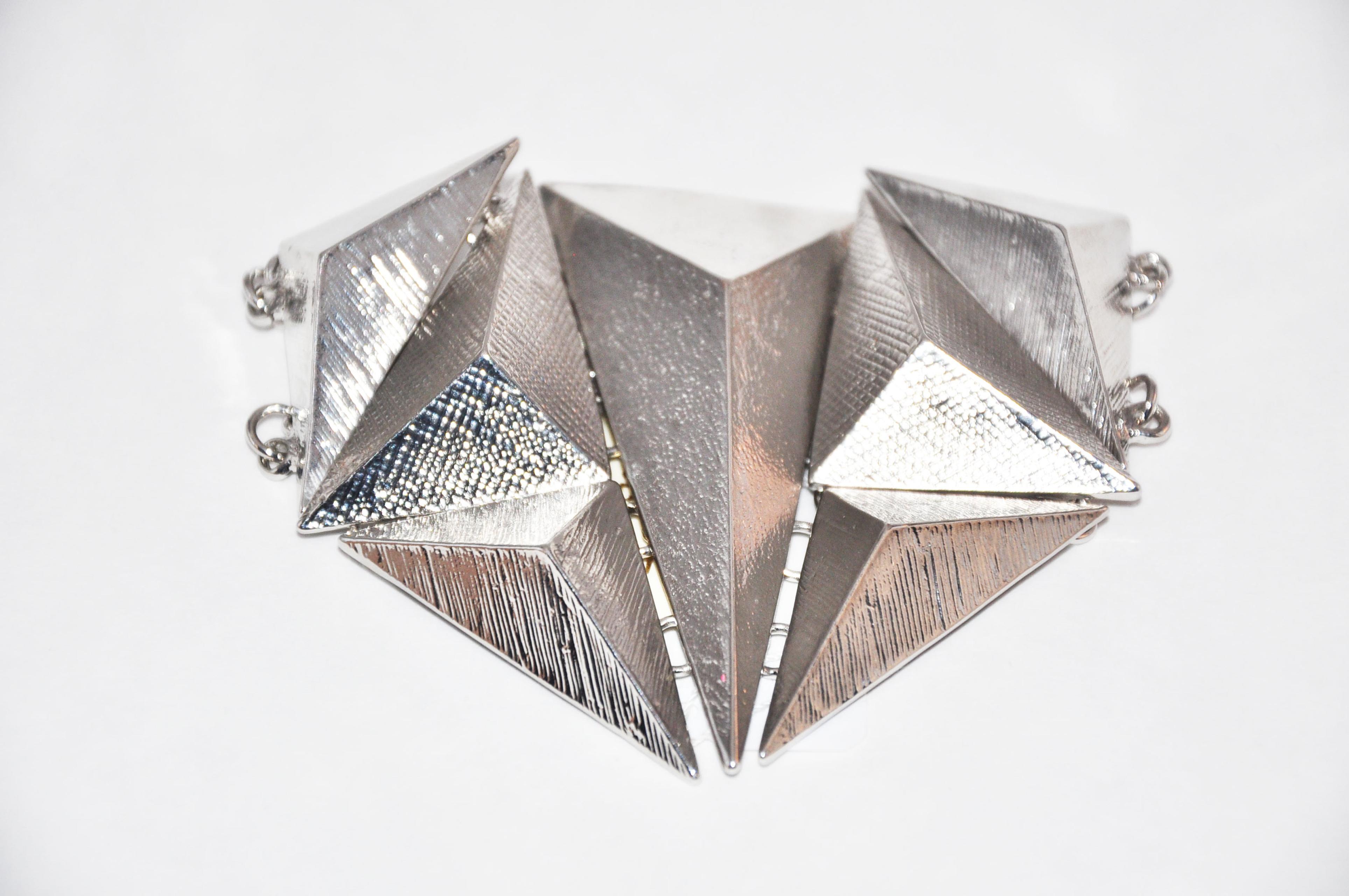 Silver triangles bracelet.