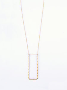 long gold-tone necklace with rectangle pendant