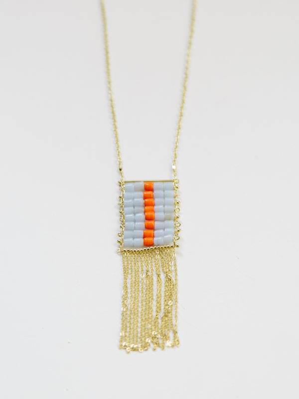 long gold tone necklace with a square of light blue and orange glass beads